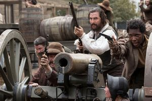 Newt (Matthew McConaughey) and his men (Sean Bridgers, left, Artrial Clark, right) in a gun battle on the main street in downtown Ellisville